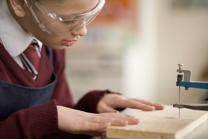 Student Wearing Eye Protection While Woodworking